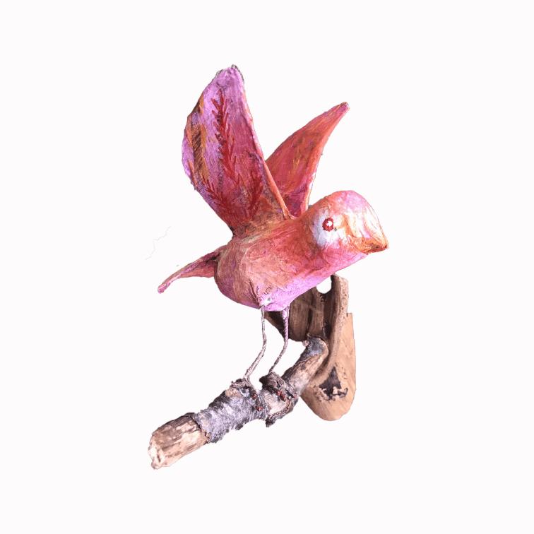 roze vogeltje dat leert vliegen