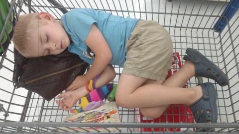 Yes, he's asleep in the shopping cart