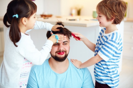 mad kids making crazy hairstyle and makeup to dad at home