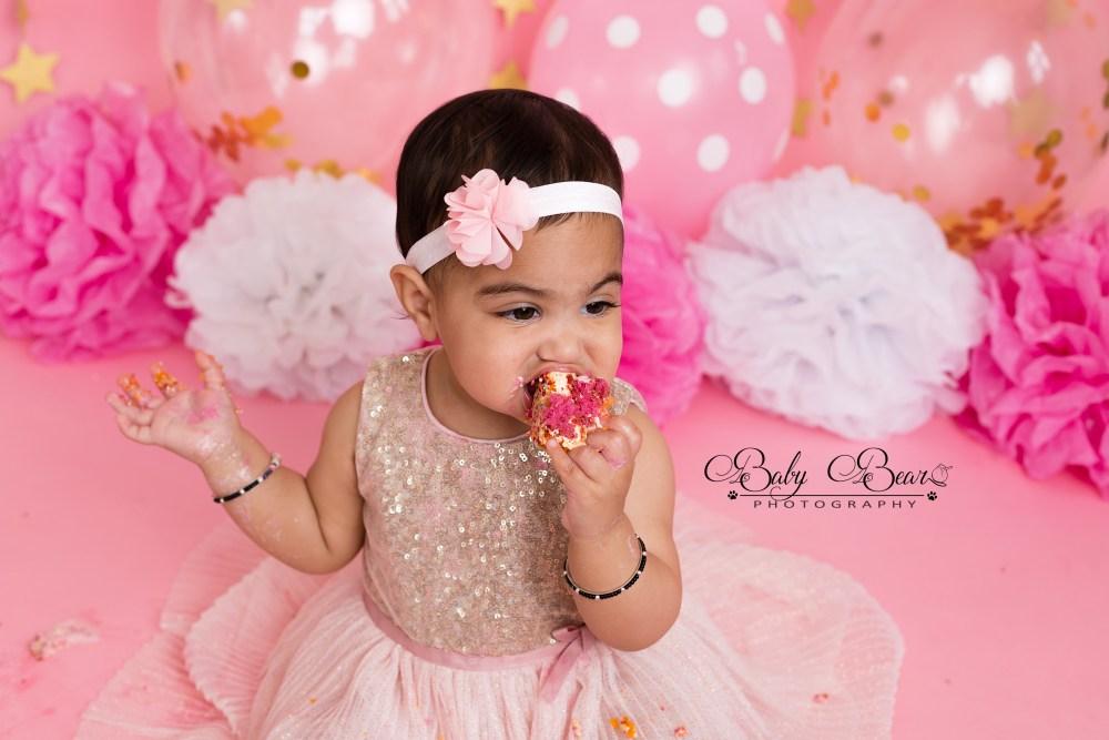 Girl in a tutu eating cake