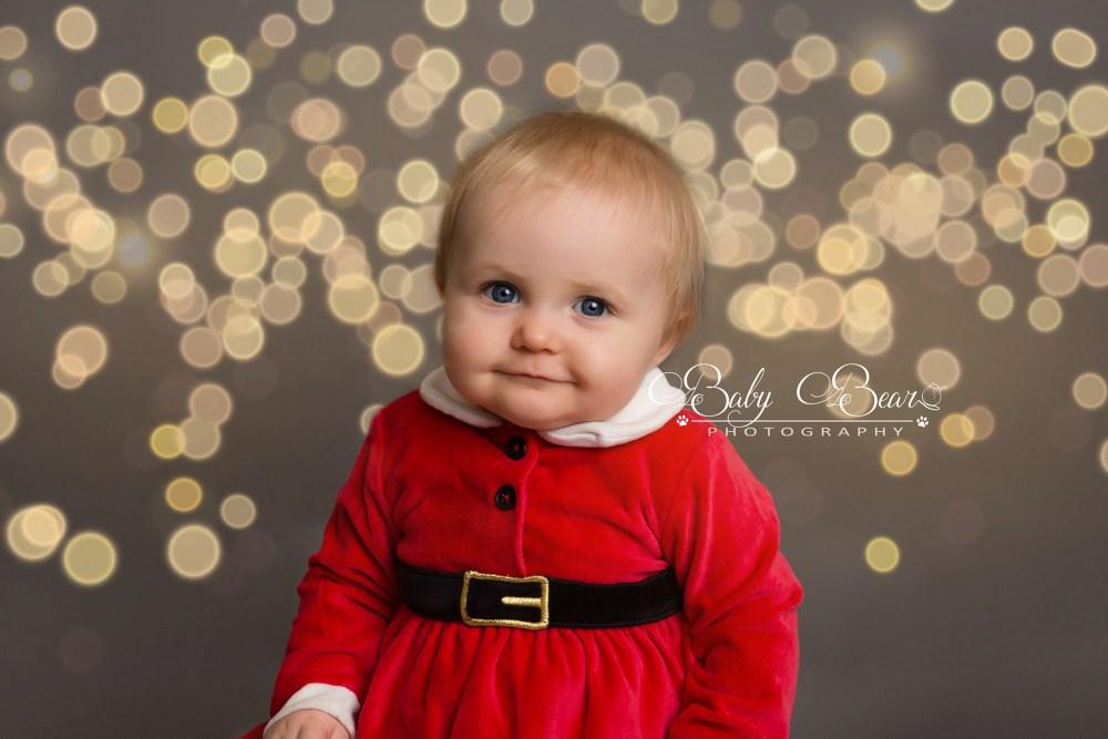 Adorable baby girl in christmas shoot