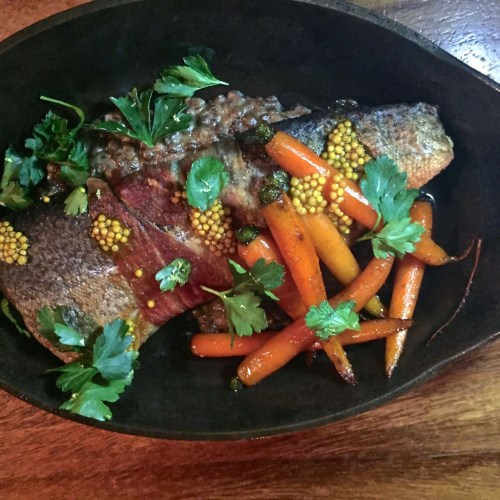 prosciutto wrapped trout with carrots and lentils