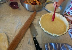 Egg white brushed inside the pie crust can help prevent it from getting soggy from a juicy filling