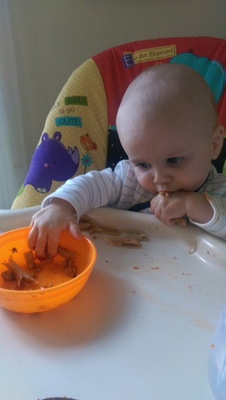 Aiden eating pasta