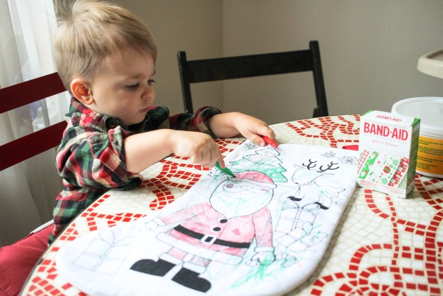 One person who deserves a special gift at holiday time is our child care provider. This we made a simple toddler DIY ornament and stocking for her.