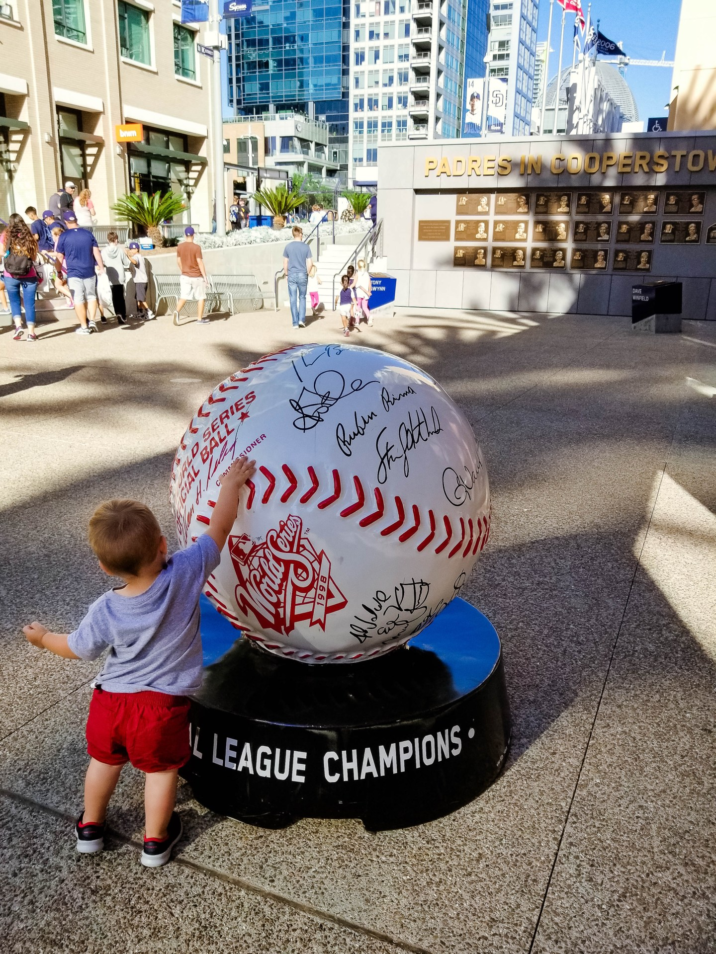 Take a toddler to Petco Park_toddler with baseball statue