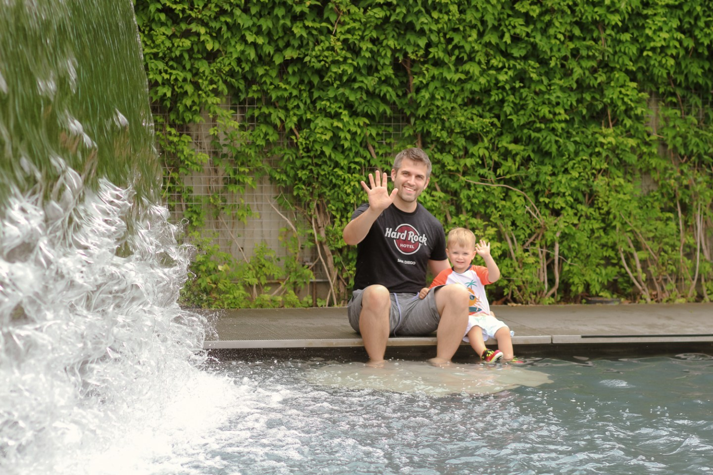 best splash pads in DC_The Yards Park_dad and toddler waving_web