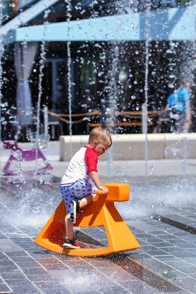 best splash pads in DC_toddler climbing rocking horse in Wharf Fountain_web