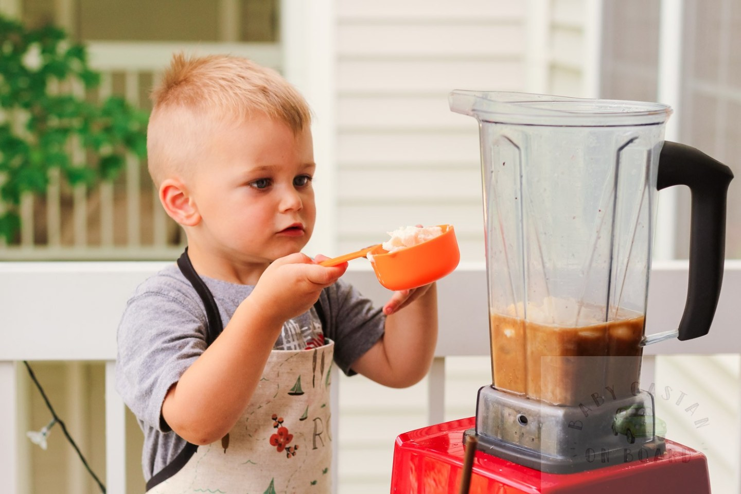 iced coffee ideas_Toddler adding ice cream to blender