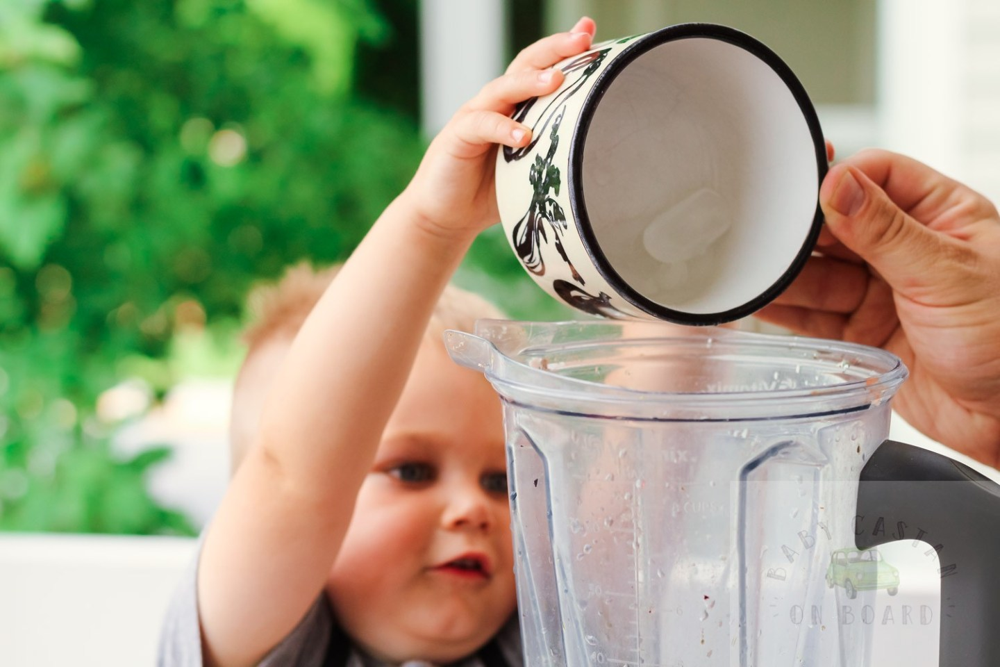 iced coffee ideas_Toddler dumping ice into blender