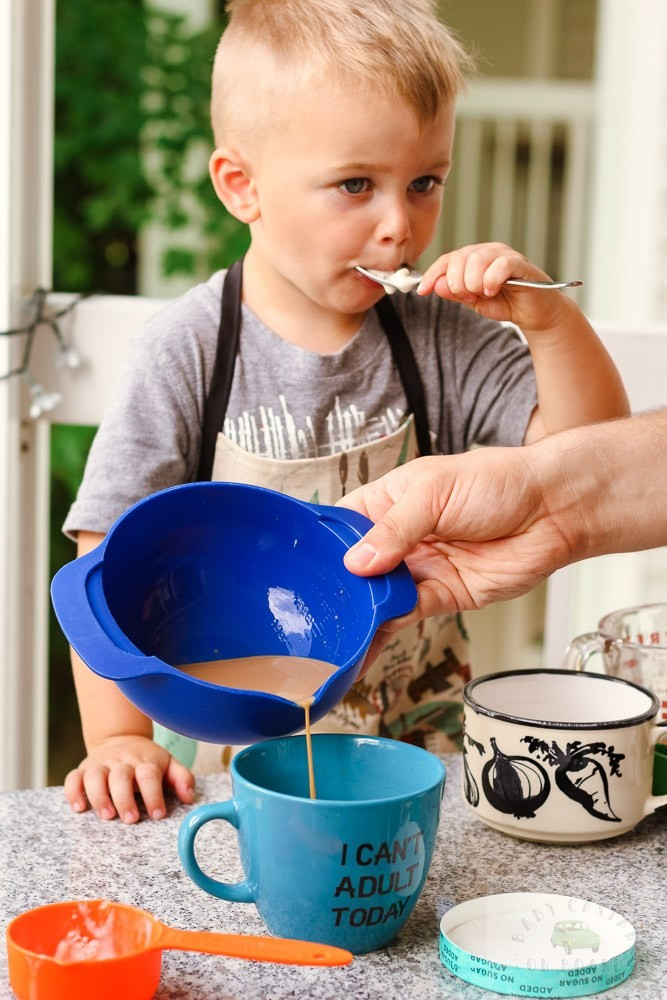 iced coffee ideas_Toddler eating ice cream dad pouring coffee
