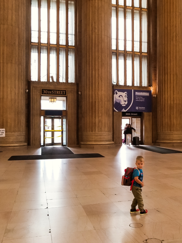 Train travel with a toddler_toddler at train station