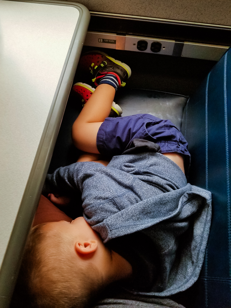 Train travel with a toddler_toddler sleeping on the train