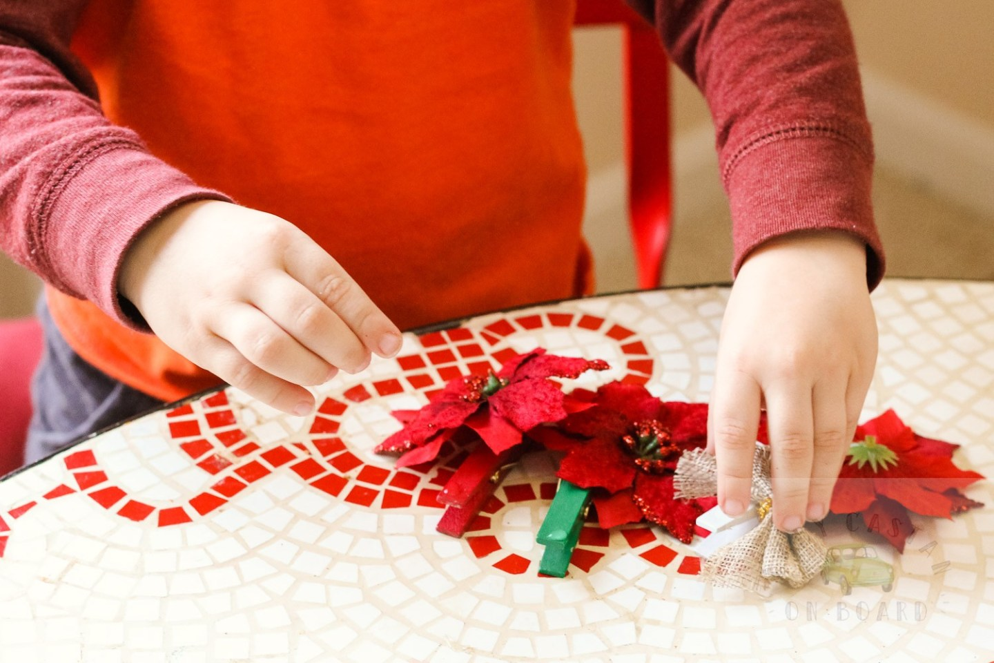 How To Make a DIY Christmas Card Holder Tree featured by top DC lifestyle blog, Baby Castan on Board: image of a child making the Christmas card holder