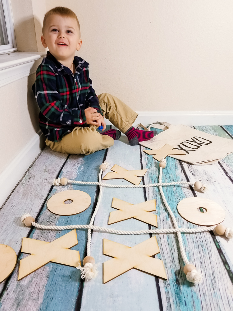 Top 3 Subscription boxes for toddlers, featured by top DC mommy blogger, Baby Castan on Board: toddler playing naughts and crosses