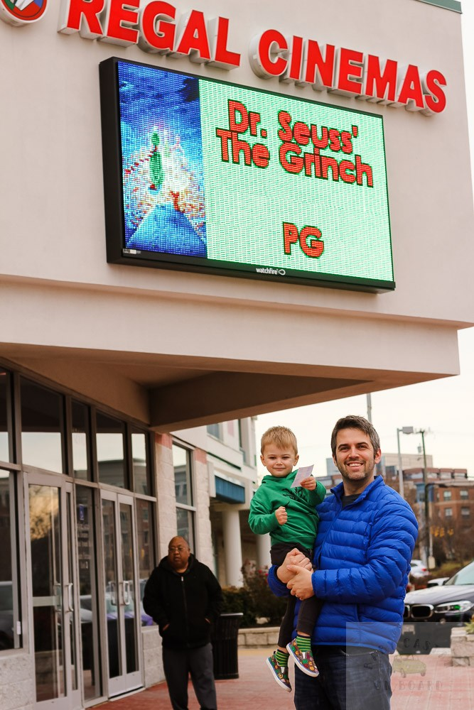 Tips for Taking Your Toddler to See The Grinch in Movie Theatres featured by top Washington DC mommy blog, Baby Castan on Board: image of a dad and toddler at the theater