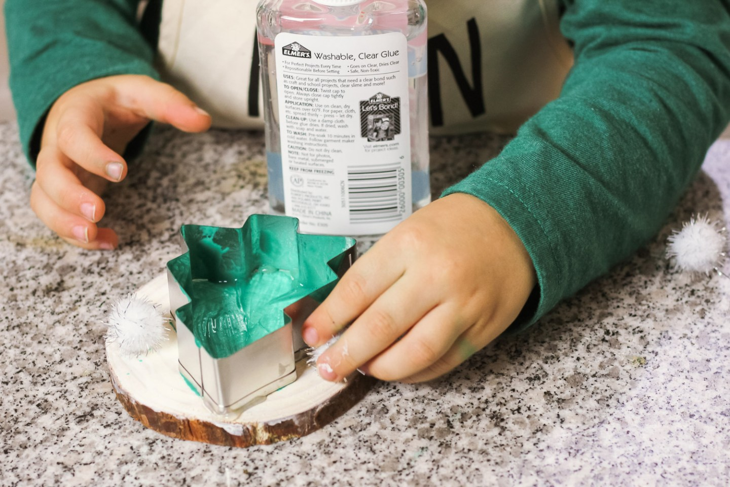 Easy Holiday crafts featured by top Washington DC mommy blog, Baby Castan on Board: image of a mom and toddler making a Christmas Tree wood slice ornament craft together