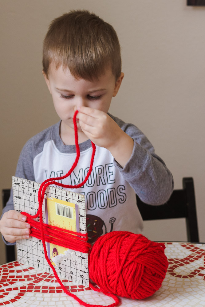 Heart crafts for toddlers_toddler wrapping red yarn