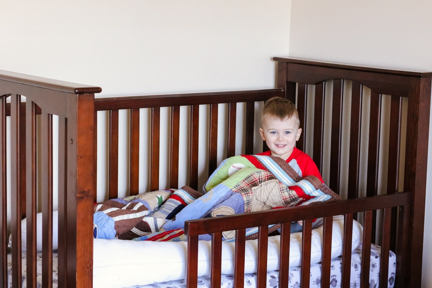 5 Essential Tips for Transitioning to a Big Boy Bed featured by top US mommy blog, Baby Castan on Board