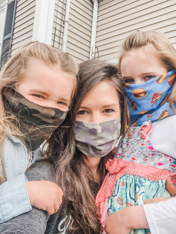 Masked mom and daughters during covid