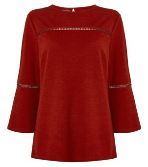 http://www.houseoffraser.co.uk/Therapy+Libby+Bell+Sleeve+Trim+Detail+Top/D681621,default,pd.html