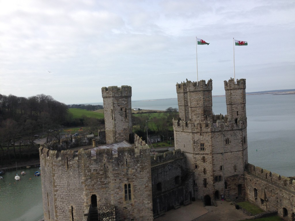 welsh flags on caernarvon castle fly high - this is a brilliant place for a family adventure to find your epic