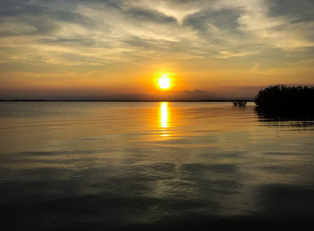 sunset over Placencia lagoon