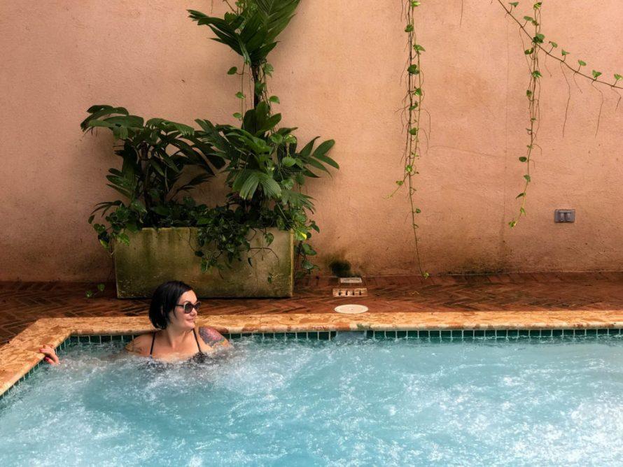 female author in pool at Casa Antillana