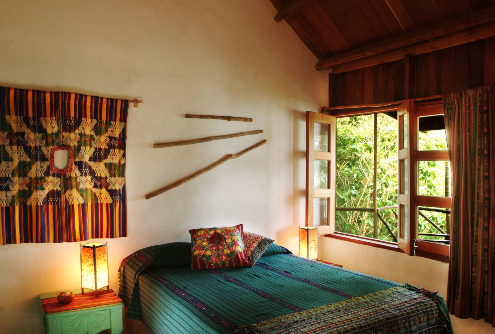 bed in Rainforest Casita at La Lancha