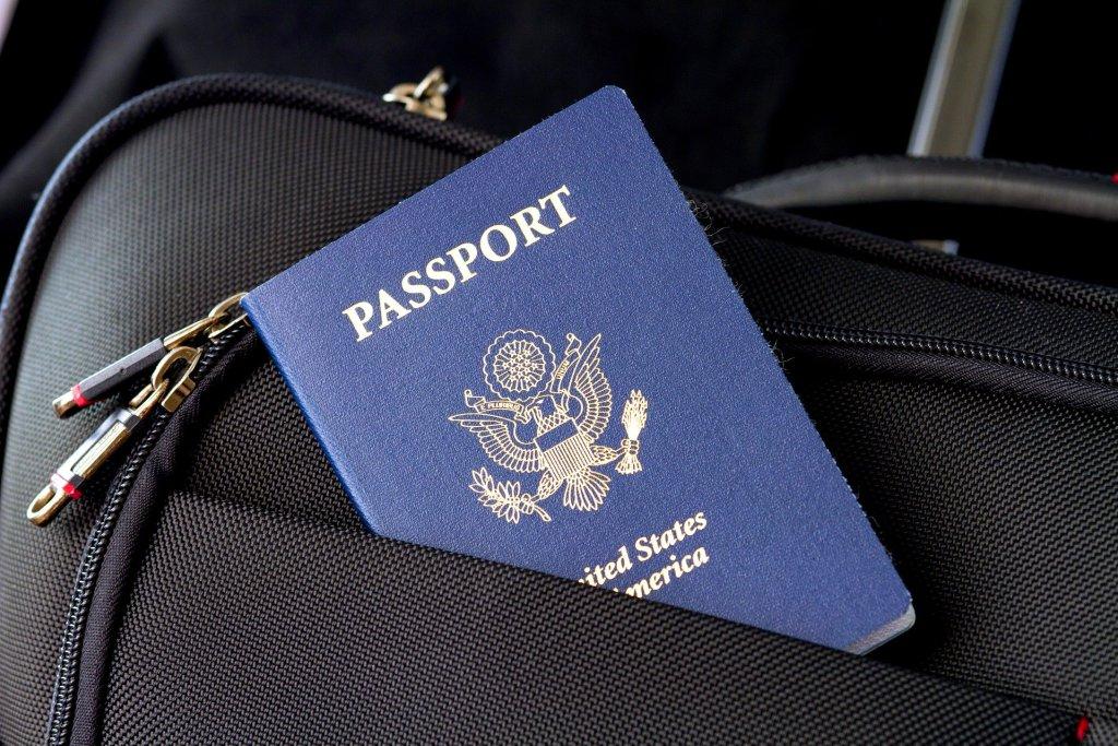 US passport tucked half way inside luggage pocket
