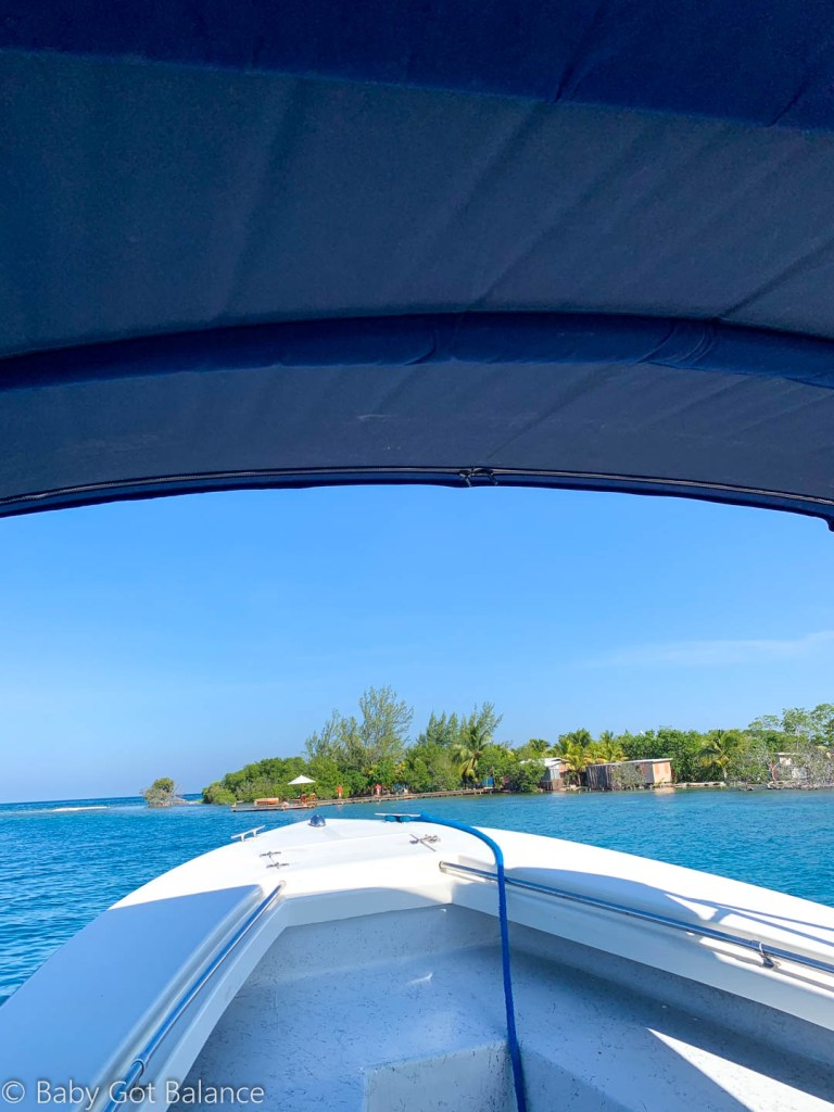 boat arriving at Coral Caye