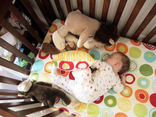 baby to crib photo