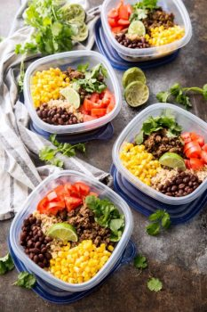 Easy taco meal prep bowls, with salsa verde beef and plenty of extras including corn, tomatoes, black beans, and cilantro