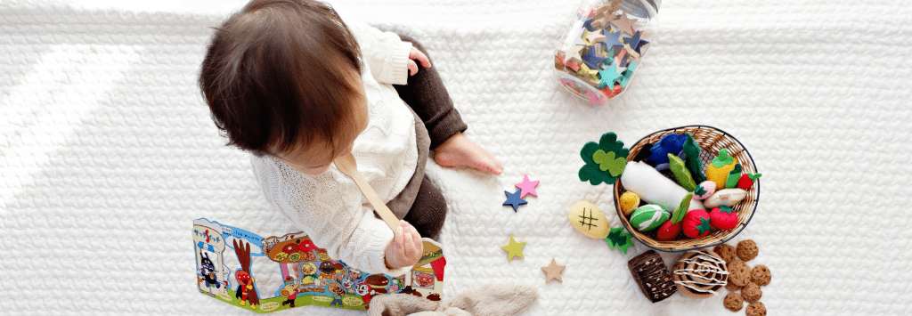 Child playing with toys and books