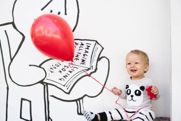 Baby with balloon featured image