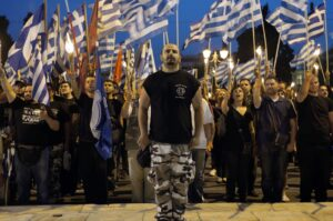 Members and supporters of the ultra-nationalist Golden Dawn party chant the national anthem in front of the Greek parliament in central Athens