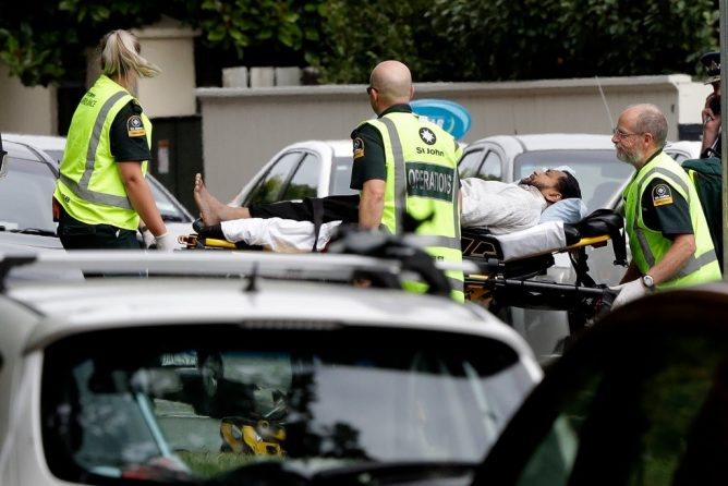 Emergency workers transporting a man from outside a mosque that was attacked in Christchurch, New Zealand, on Friday.