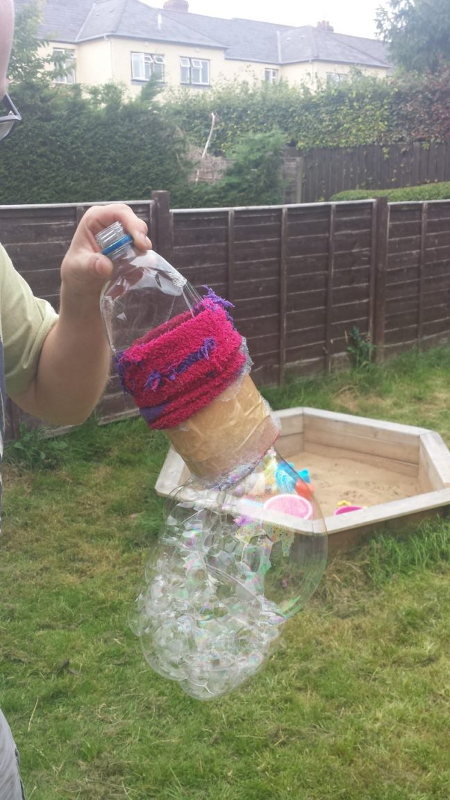 see who can make the longest bubble snake by blowing into the bottle