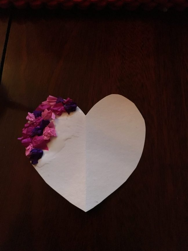 tear up tissue paper in different colours of pink and purple and stick to the heart