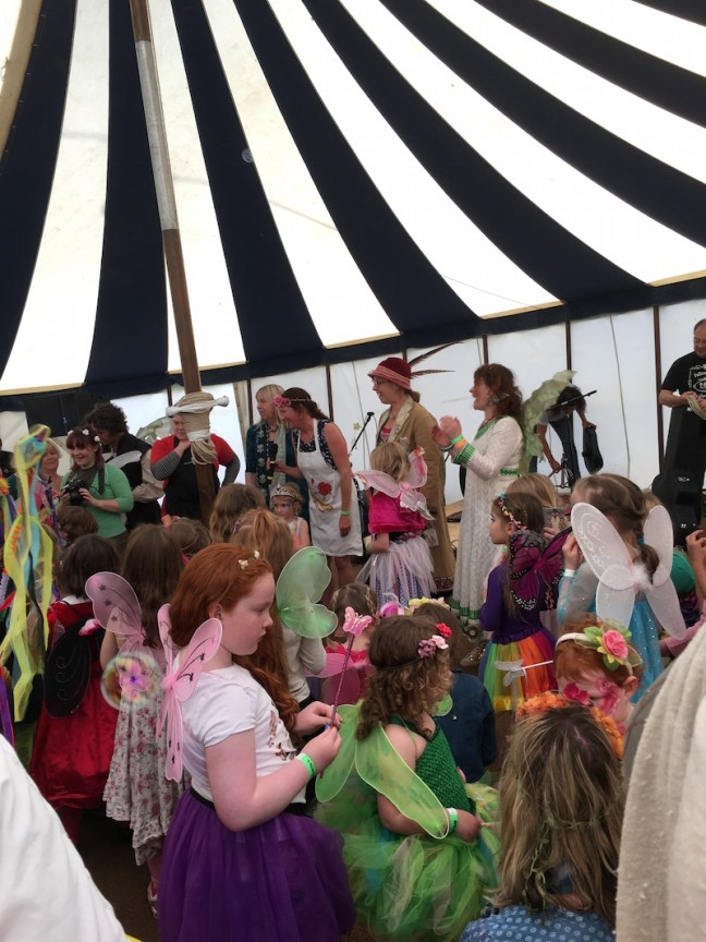Children in the big top being judged for the best dressed fairy competition