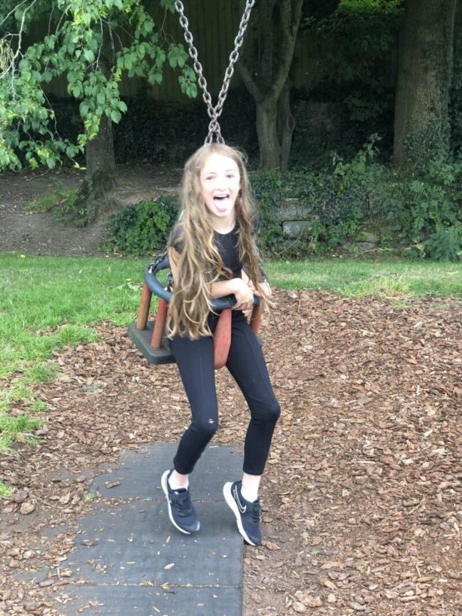 10 year old girl stuck in a baby swing at the park