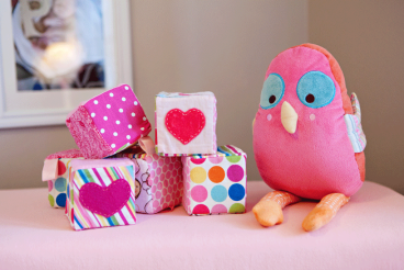 These sweet fabric blocks (with noise-makers inside!) and happy bird were made by Merrick with scrap fabric that she used elsewhere in the nursery.