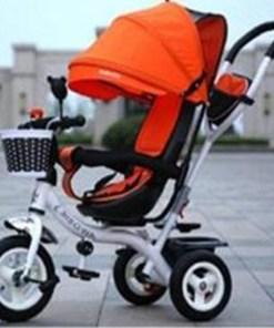 Tricikl sa rotirajucim sedistem orange