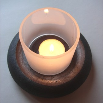 Lundi lysestake med lite lys / candle with small light