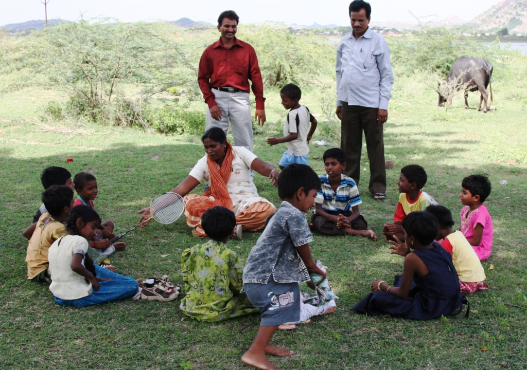 The children play an Indian version of duck, duck, goose