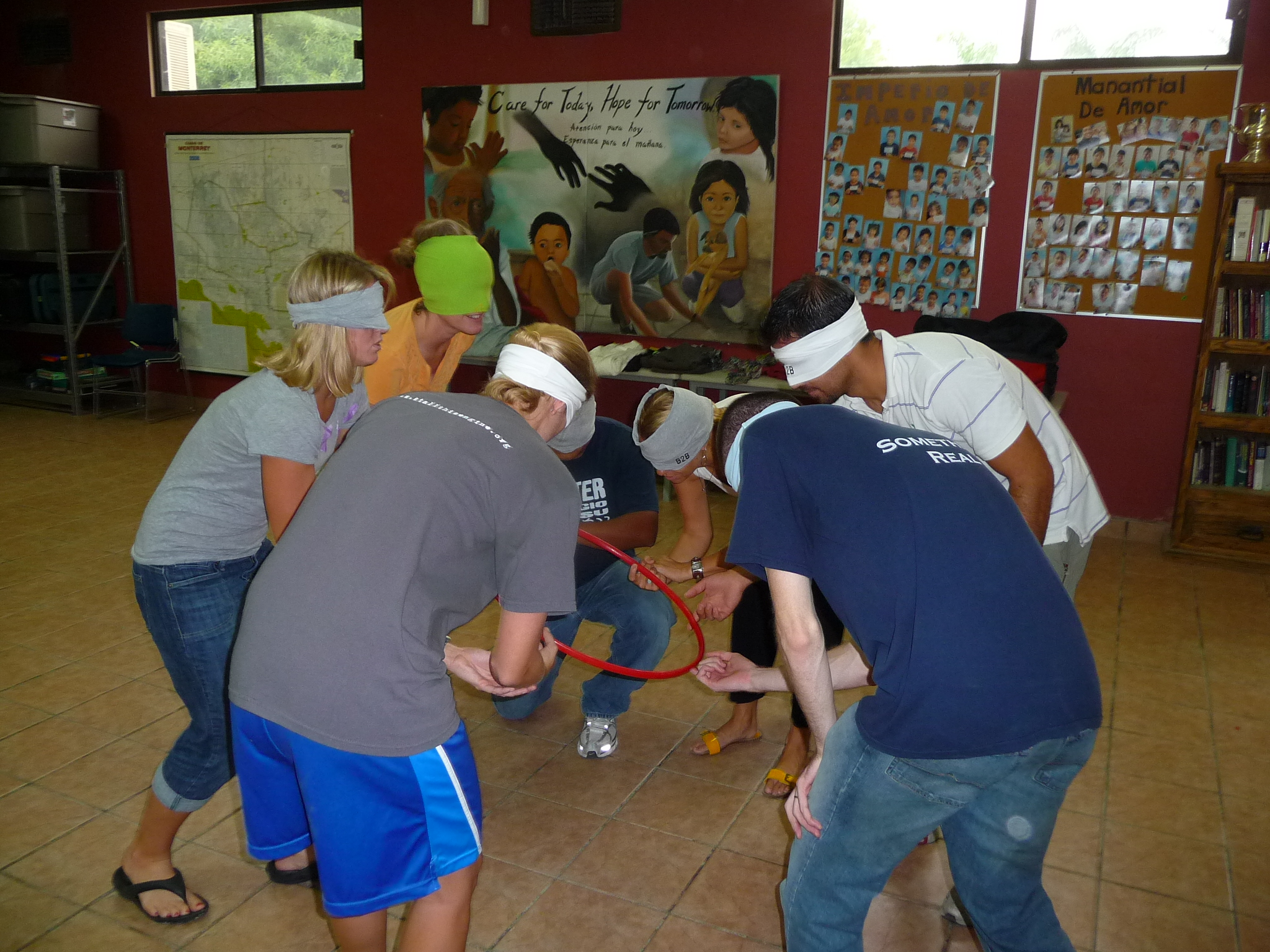 The staff split into small groups for a series of team-building activities
