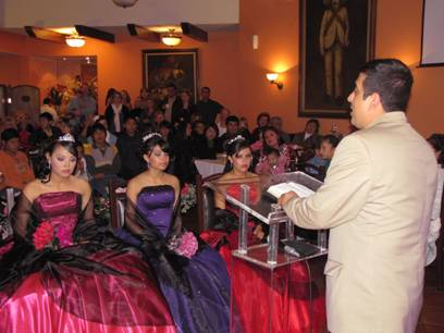 Edgar sharing a message during the quincenera