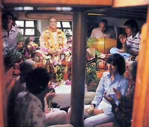 Devotees and friends chant Hare Krsna in the boat's temple cabin .