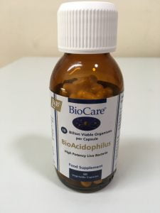 Image shows small brown glass bottle containing probiotics