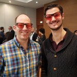 Eastbourne Chiropractors James Revell and Mykel Mason. Shown wearing red glasses at a recent conference.